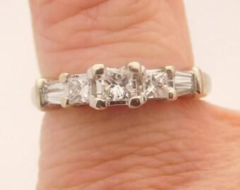 0.75 C.T.W. Ladies Princess & Baguette Cut Three Stone Diamond