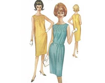 Vintage 1960s woman dress pattern, McCalls  6724, size 12, shift, center back zipper, sleeveless, yoke smocking, self fabric belt, UNCUT