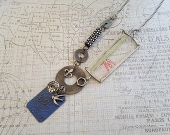 "Altered Art, Mixed Metals, Found Objects ""WE""+Blue ""BOLT"" Necklace: Padlock, Rhinestone Industrial Part, Washers, Button, Bird, Fleur de Lis"