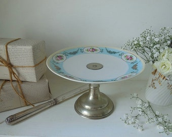 Beautiful antique cake stand. Handpainted porcelain and silver plate