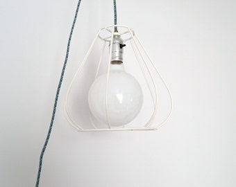 Recycled hanging side lamp with switch.