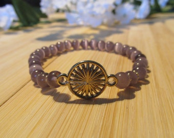 Lilac bracelet with a gold charm