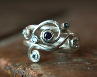 Recycled sterling silver ring. Set with Moissanite & Fair Trade stones. Hand made in the UK. Size K