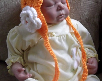 Beautiful Baby Bonnet...Mango Orange with White Layered Flower...All Handcrocheted...Long Drawstrings..Delicate Design..0 up to 3 Month Size