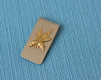 brushed metal money clip with brass insect