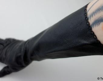 1940s-50s black leather elbow-length glove with tiny eyelet trim at bottom hem, size 7 softest thin black leather gloves