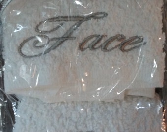 Luxurious White Face and Body Cloths with Gray Lettering