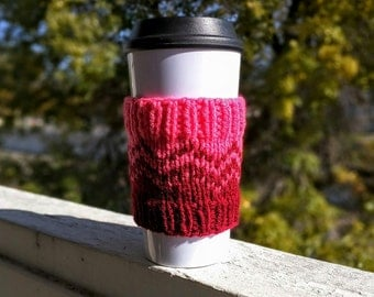 Knit coffee cozy sleeve in red and pink