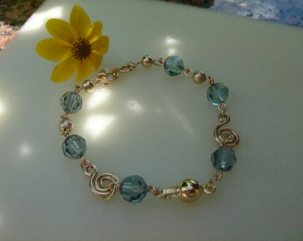 Bracelet gold, gold filled with spirals and Crystal, blue