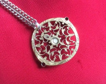A Victorian interior watch cover or guard to protect the mechanicals of the watch, made into a necklace.