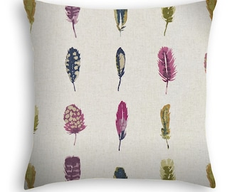Bird feathers Pillow Cover in pomegranate, raspberry and olive on a neutral background.  Luxury european fabric brand.