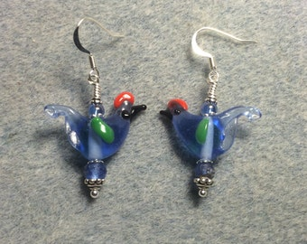 Translucent blue red crested lampwork songbird bead dangle earrings adorned with light blue Czech glass beads.