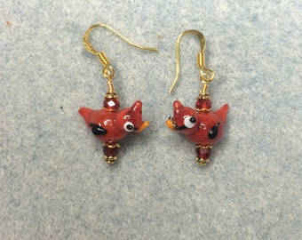 Tiny red cardinal bird lampwork bead earrings adorned with red Chinese crystal beads.