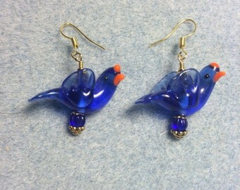 Bright blue lampwork flying songbird dangle earrings adorned with bright blue Czech glass beads.