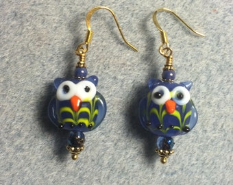 Bright blue lampwork owl bead earrings adorned with bright blue Czech glass beads.