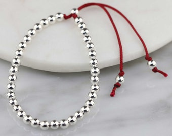 Silver Bead and Cotton Thread Friendship Bracelet