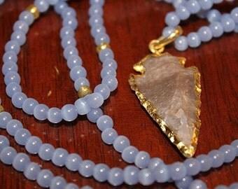 Purple beaded necklace with arrowhead pendant