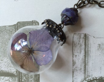 """Glass Globe Necklace with Dried """"Violet"""" Flower."""