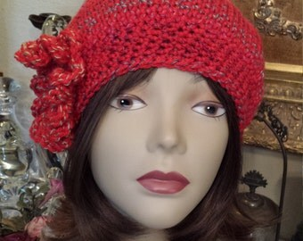 Handmade crochet winter hat with flower designed and made by petronella