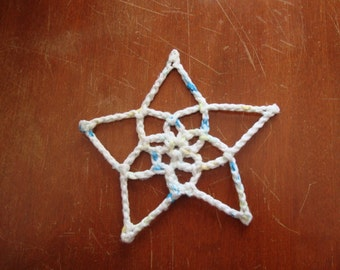 White crocheted five point star