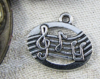 Set of (12) Silver Staff and Music Note Charms, 12 per package ART020