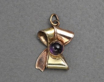 Two toned 9K gold & amethyst bow charm