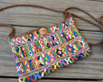 Rare, one of kind, silk, handwoven purse. Beautiful colors, simplistic design and truly a piece of art.  Hand woven in Guatemala.