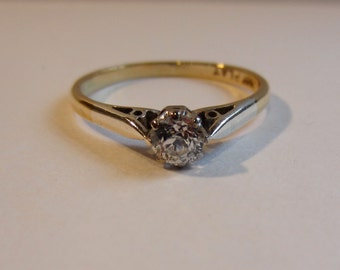 18ct gold and platinum  solitaire diamond ring