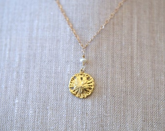 Baby Sand Dollar - This beach-themed pendant is perfect for all ages.