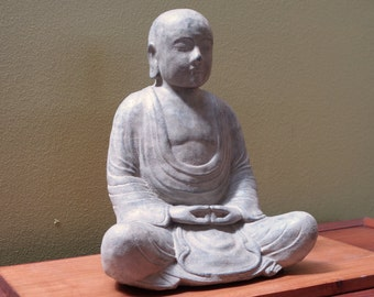 Monk statue made of volcanic ash. zen, buddhism