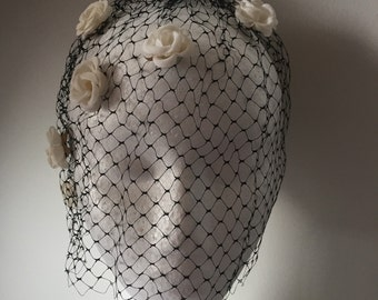 1960s vintage net veil hat with flowers in original box.