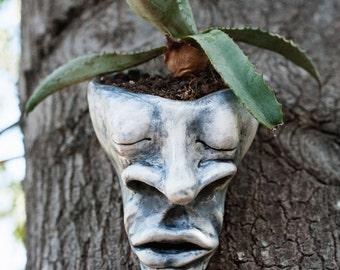 Zen sleeping head planter