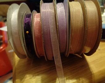 7 partial spools of 1/4 inch organza ribbon