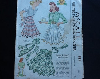 McCall pattern 884. Vintage 1941 misses' necktie apron. Accordion effect from narrow sections shaped like men's neckties. One size.