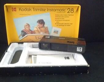Kodak Trimlite Instatmatic 28 camera with books and Box.