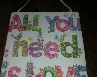 Decoupaged all you need is love plaque