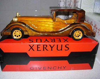 stunning super rare givenchy hand craved and finished wooden model car