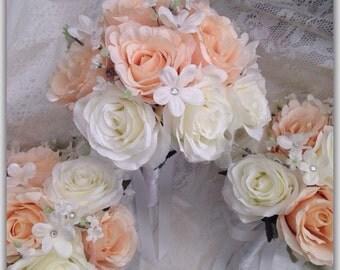 Peach bouquet, white roses.