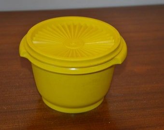 Tupperware solar cover canister, yellow