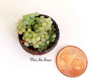Green  grapes in a basket.