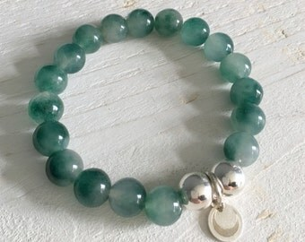 Beaded jade bracelet with sterling silver crescent moon charm