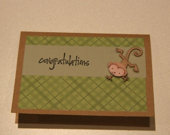 "Baby monkey ""congratulations"" card"