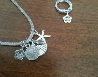 The four pendants necklace.silver set with a ring