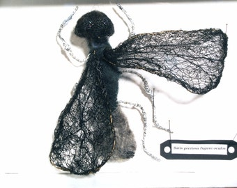 Sculpture of textile art, fake taxidermy, fly