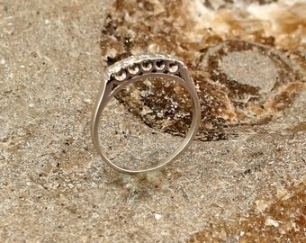 Dainty White Gold and Five Diamond Ring