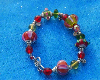 Sale:  Lampwork Bead Bracelet - Red, Pink and Green Glass beads