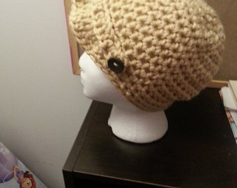 Tan Newsboy hat.
