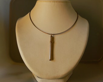 Mechanic toothpic , pendant . Gold plated , retracting , sliding .