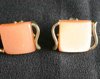 Vintage clip on earrings.  Peach colored with gold tone metal.   Coro brand. Very beautiful. Would make a lovely gift.