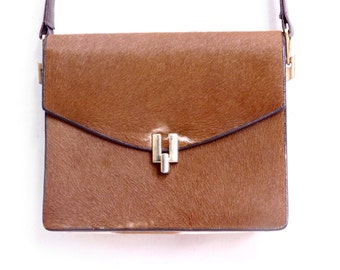 Furry calf hide shoulder bag from the 1970's